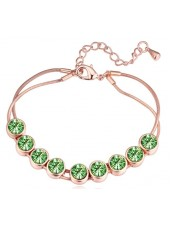 Браслет Радужные кристаллы Swarovski с зелеными кристаллами в золоте